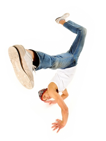 people dancing: breakdancer does moves while perfoming a hand stand