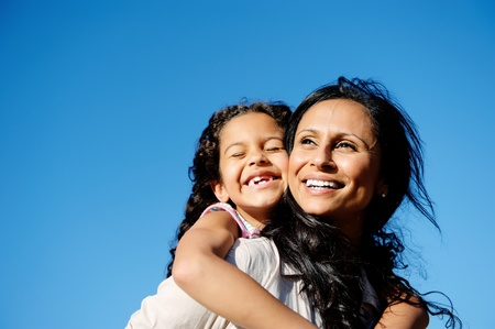carefree vitality image of mother and daughter playing together outdoors photo