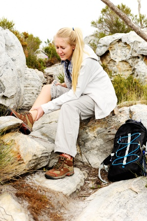 beautiful ankles: A woman has sprained her ankle while hiking Stock Photo