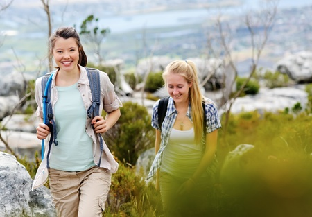friends hiking together outdoors exploring the wilderness and having fun Stock Photo - 11900329