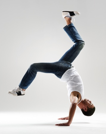 handstand dancer in mid air displaying supreme control and strength Stock Photo