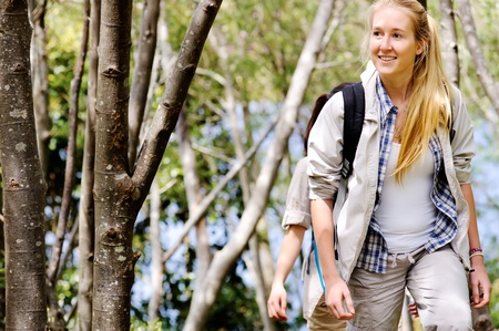 Women walking outdoor in the woods, happy exploring and adventure lies ahead for these wilderness trekking friends Stock Photo - 11898665