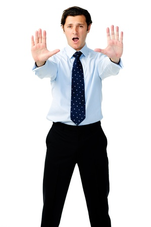 displeased businessman: Displeased businessman holds both hands up to show a stop signal and yells in the background Stock Photo