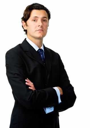Hombre de negocios confidente posa para un retrato con una cara seria en el estudio aislado en blanco