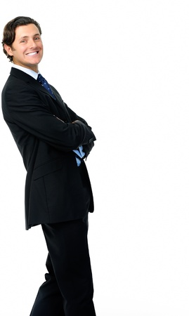 Smart looking businessman leans back in a relaxed stance photo
