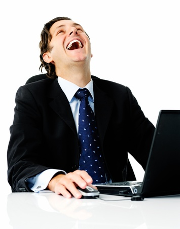 he laughs: Businessman laughs from his desk when he hears that he sealed the best deal of his life Stock Photo