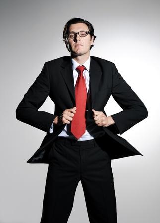 lapels: Fashion model in formal business attire grabs onto his suit lapels