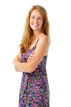 Natural looking redhead smiling confidently with her arms folded for a portrait Stock Photo - 11900334