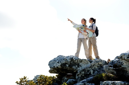 rambling: hikers with map pointing in the right direction