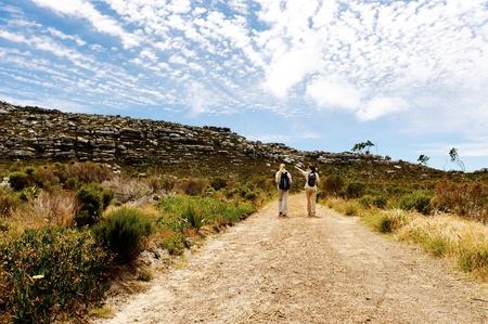 rambling: two girls walking outdoors and having fun exploring the wilderness