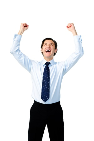 Excited businessman celebrates by pumping fists photo