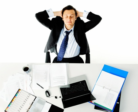 leans: Office worker takes a break from his work and leans back daydreaming