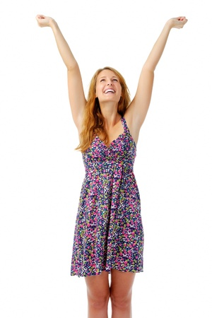Attractive woman raises her arms overhead in celebration after hearing some good news Stock Photo - 11900343