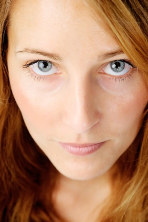Close up portrait of a redhead caucasian woman looking up, with barely any make up Stock Photo - 11900187