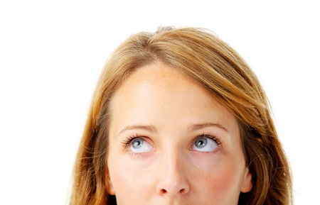 Close up of a partial woman's face looking up towards a corner Stock Photo - 11900275