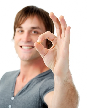 man gives ok signal towards camera isolated Stock Photo - 11900345