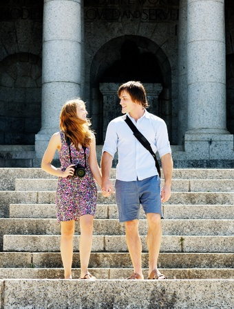 tourist couple travel and take pictures of famous monuments and temples photo