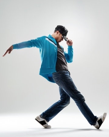 hip hop dance: cool modern breakdancer warming up in studio,