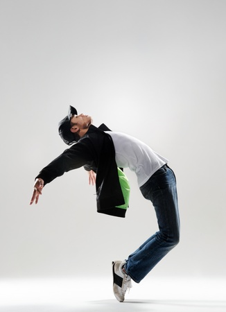 dance pose: expressive dance move where the modern dancer bends backwards and shows his emotions