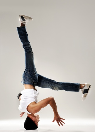 break in: breakdancer frozen in mid head spin, classic modern hip hop or break dance move Stock Photo