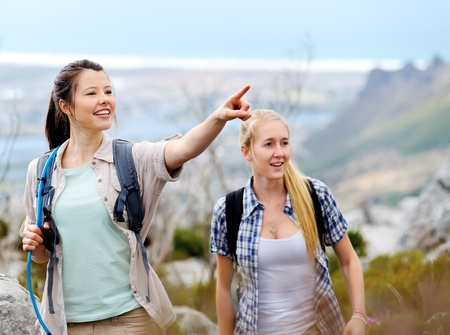friends hiking together outdoors exploring the wilderness and having fun Stock Photo - 11900353