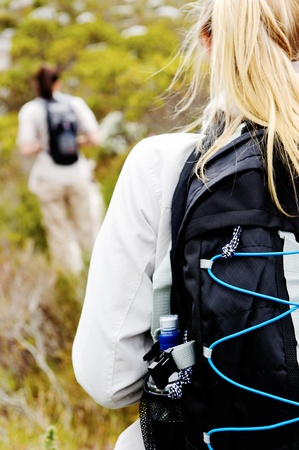 closeup shot of a backpack on a womans back hiking outdoors Stock Photo - 11900091