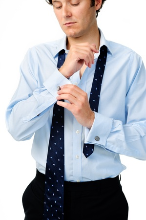 Anonymous caucasian man adjusts his cufflinks while preparing for work photo