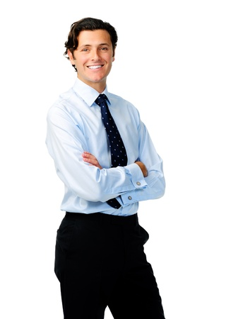 Attractive caucasian businessman stands with his arms crossed and a welcoming smile photo