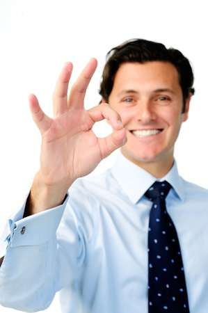 ok hand: Confident, happy businessman shows the OK hand sign for a successful day