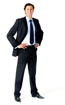 hands on hips: Smiling relaxed businessman poses for a full length portrait, isolated on white
