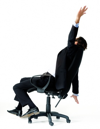 restless: Restless office worker turns in his seat and throws his arms in the air