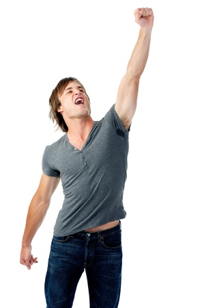 fist pump: man clenches fist and punches air with intense emotion of victory celebration Stock Photo