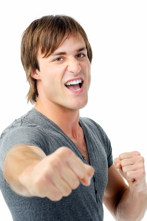threatening: scary man with fists clenched boxing towards camera showing agression Stock Photo