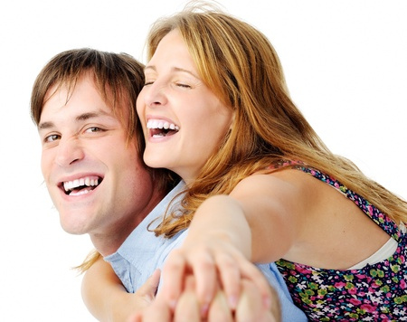vibrant colours: laughing couple have fun together as they play and smile isolated on white, vibrant colours Stock Photo