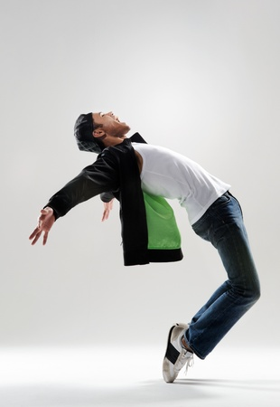 expressive dance move where the modern dancer bends backwards and shows his emotions photo