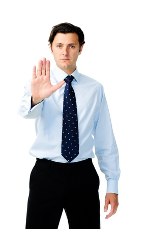 displeased businessman: Displeased businessman holds his hand up to show the stop hand sign