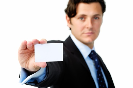Serious businessman holding a blank card suitable for your companys contact details photo