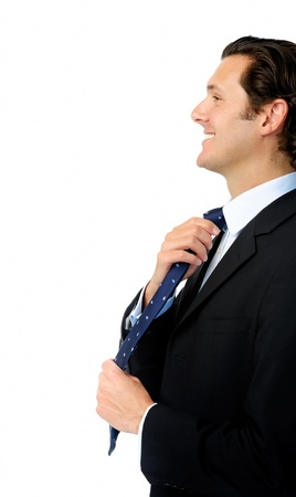 Handsome man adjusts his tie while getting ready to work photo
