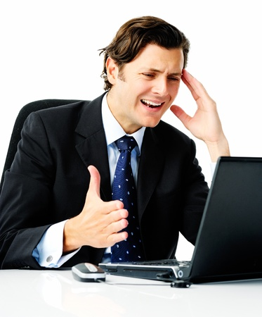 arises: Businessman in suit curses at his laptop computer when a problem arises