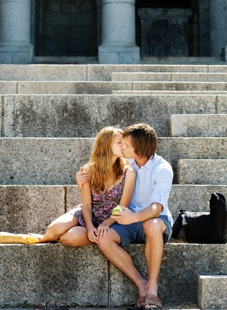 Good looking couple in love shows affection for each other while sitting in the sun Stock Photo - 11898666