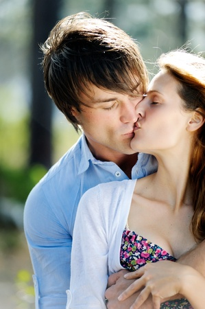 true love: beautiful young couple kiss outdoors in the forest, true love and passion