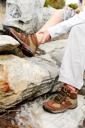 ankle: A woman has sprained her ankle while hiking Stock Photo