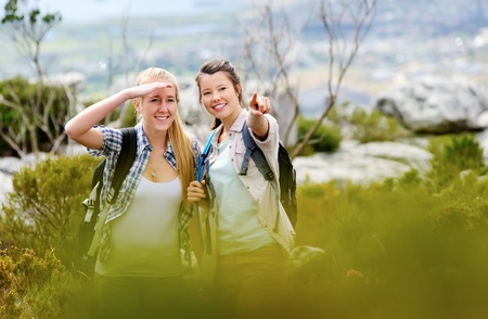 friends hiking together outdoors exploring the wilderness and having fun photo
