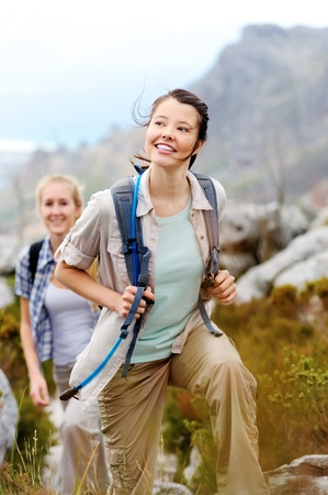 friends hiking together outdoors exploring the wilderness and having fun Stock Photo - 11900231