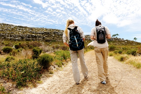 two girls walking outdoors and having fun exploring the wilderness photo