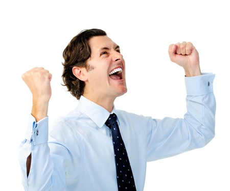 fist pump: Excited businessman celebrates by pumping fists Stock Photo
