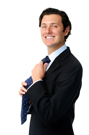 adjusting: Handsome man adjusts his tie while getting ready to work