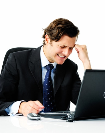Businessman in suit works too hard and suffers from a painful migraine photo