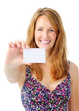 Smiling woman holds out an empty white card for designers to insert contact details photo