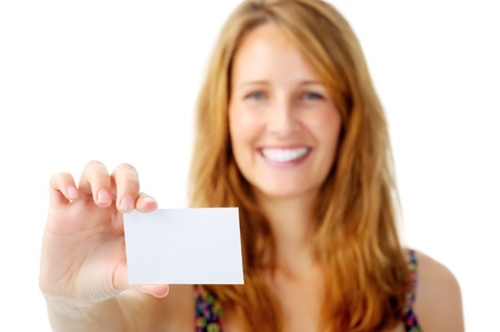namecard: Smiling woman holds out an empty white card for designers to insert contact details Stock Photo
